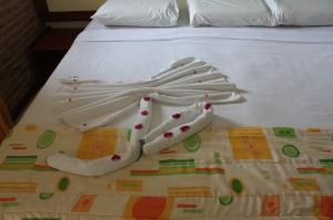 Decoração em cima da cama
